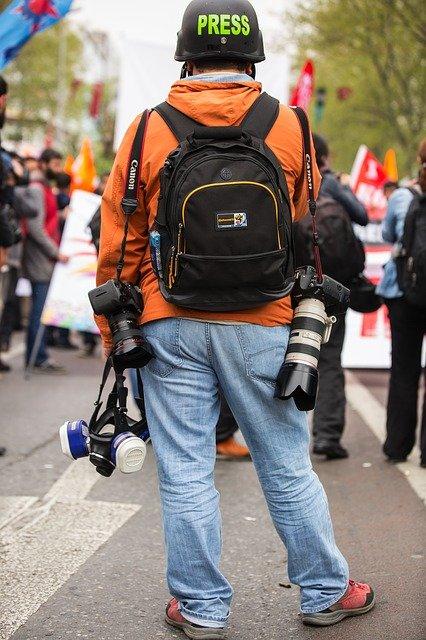 photographe de presse, de dos